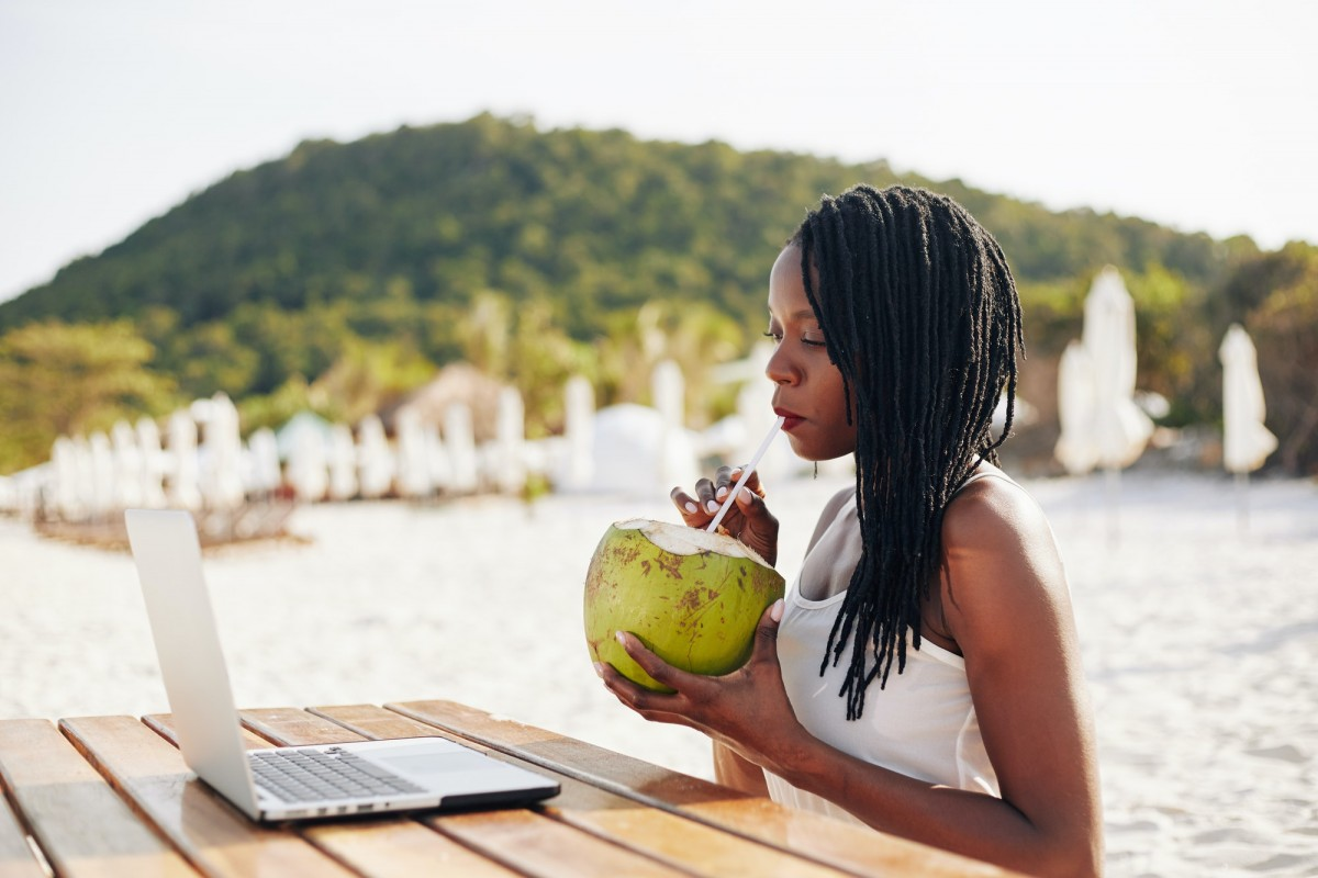 Woman drinking refreshing coconut water