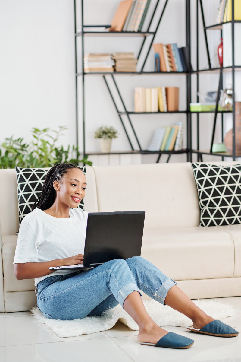 Woman coding on laptop at home