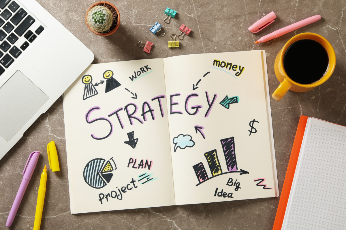 Concept of business strategy on gray table, top view